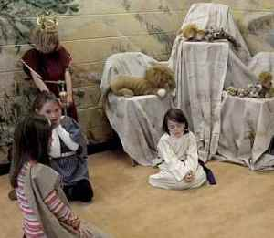 Daniel is thrown into the den of lions