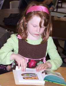 a child reads a Bible