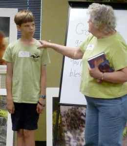 Sandy blesses her grandson