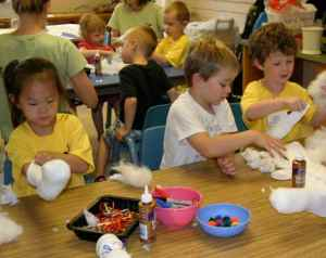 Kids in preschool crafts create a baby doll