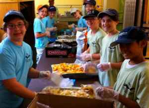 Grad Group preps food for LOVE Thy Neighbor