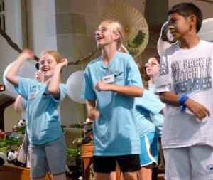 The grad group helps lead singing