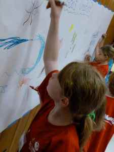 Kids in Crazy Crafts work on the God's creation mural