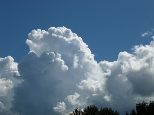 Puffy white clouds against a blue, blue sky