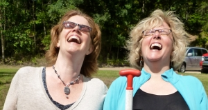 Two women share a laugh