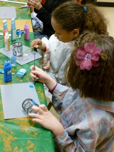 3rd graders paint stained glass candle holders