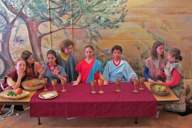 The 5th graders create a tableaux of The Last Supper