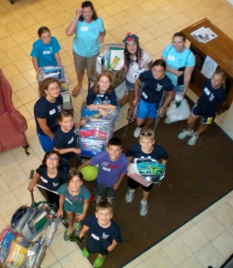 Grad group heads off to deliver school kits