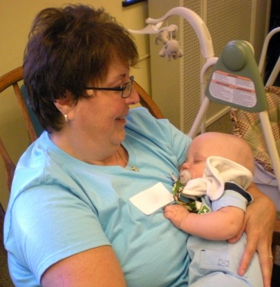a baby is held in the nursery