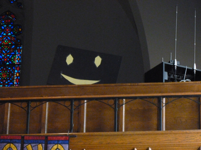 the mysterious smiley face in the balconey