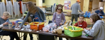 Families participate in a service project