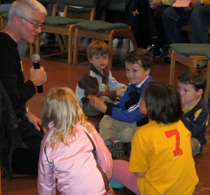 Children have a time with the pastor at church