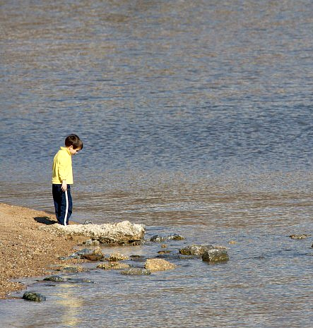 A child contemplates rocks