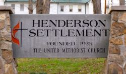 The Henderson Settlement sign