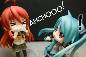 a cartoon figurine sneezes Ahchooo!