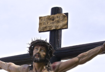 Showing the placard on the cross above Jesus' head
