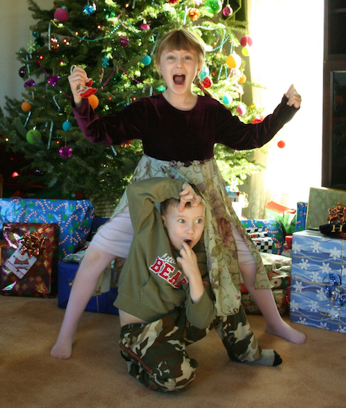 kids acting bizarre in front of the Christmas tree